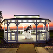 bride and groom dancing inside wedding gazebo
