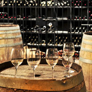 Wine glasses on top of a barrel in a wine cellar