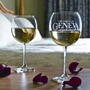 Two glasses of wine on a table in a hotel room